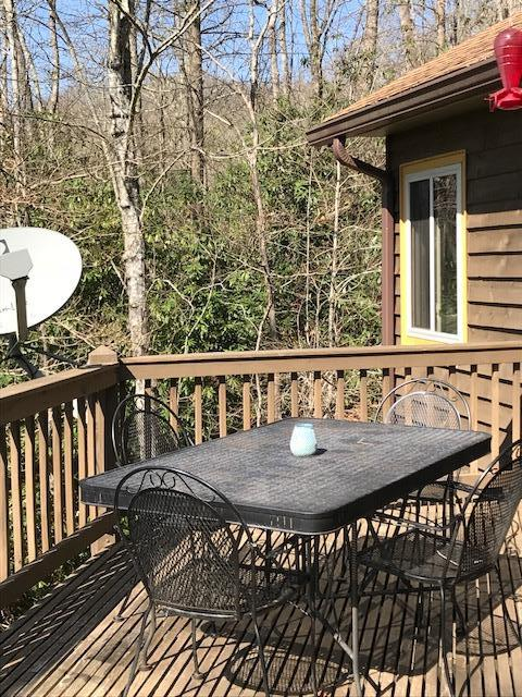 Outside decks with table and grill
