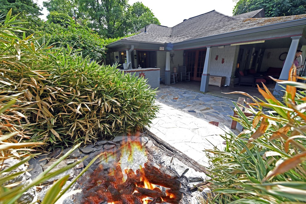 Mature landscaping and fire pit